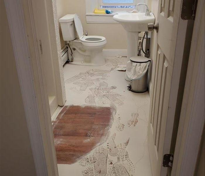 Dirty bathroom covered in fire extinguisher debris