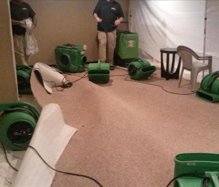 SERVPRO equipment in empty and clean basement