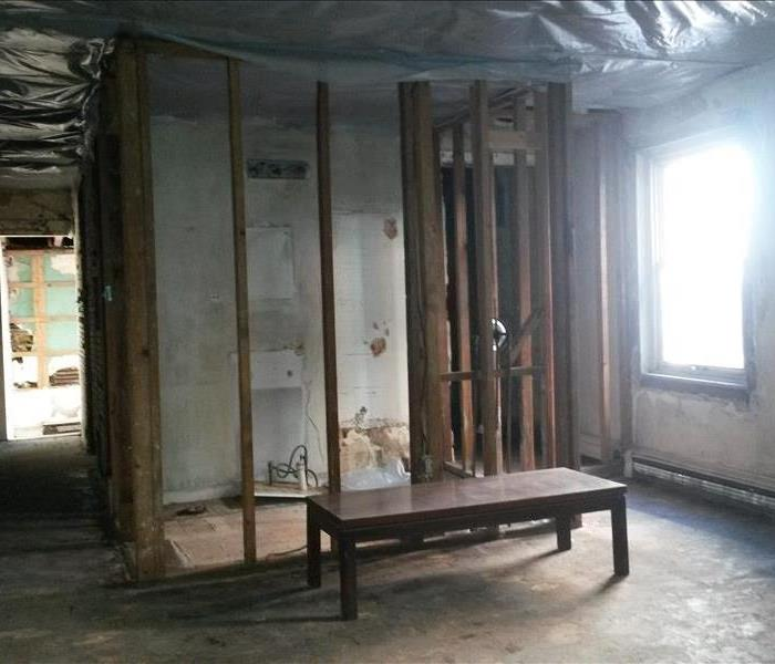 Mid-reconstruction of wall and room cleaned of all soot