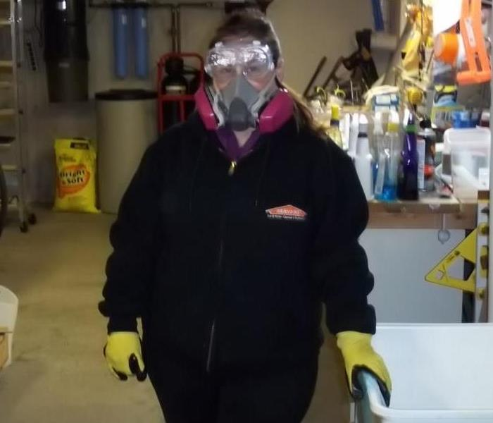 Michele with mask on in her black SERVPRO uniform